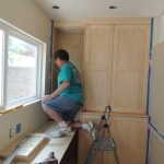 Dave finishing cabinet install