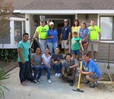 Rotary labors for Caring House