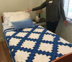Caregiver Tracy shows off a new bed